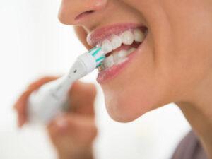 lavarse los dientes - cepillo eléctrico